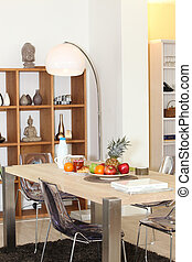 Continental breakfast laid out on a smart dining room table