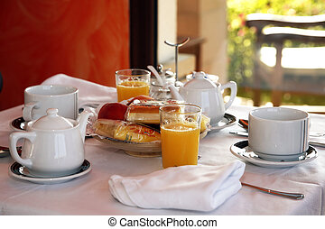 Delicious continental breakfast consisting of coffee, orange juice, croissant, boiled egg, jam,