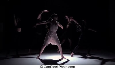 Continue contemporary dance of five dancers on black, shadow, slow motion