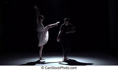 Continue graceful contemporary dance of couple dancers on black, shadow, slow motion