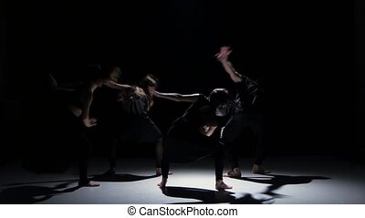 Continue of contemporary dance performance of five dancers on black, shadow