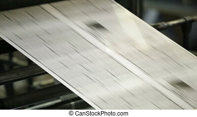 Continuous sheet - Continuous newspaper sheet moving fast...