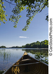contorno costa, lago, canoa