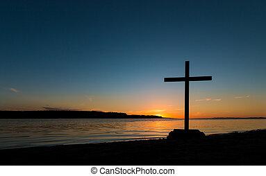 contorno costa, pôr do sol, crucifixos