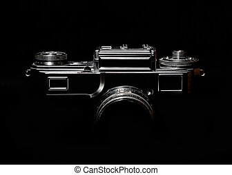 contour of a vintage camera in the dark