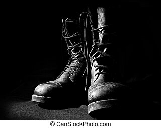 contour of military boots on black background front view