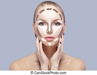 Contouring. Make up woman face on grey  background. Contour and highlight makeup.