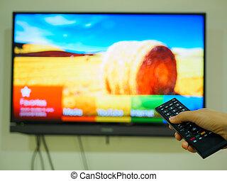 contrôle, éloigné, tv, haut, possession main, fin
