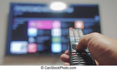 contrôle, concept, fermé, cinéma, tv, main., ligne, apps, commandes, remote., virage, mâle, tenue, internet, style de vie, main, éloigné, intelligent, homme