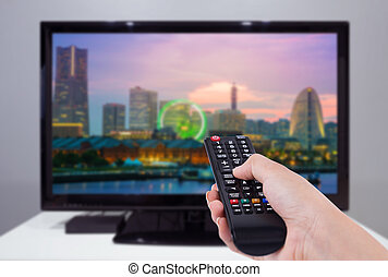 contrôle, ville, télévision éloigné, tenue, écran tv, main, fond