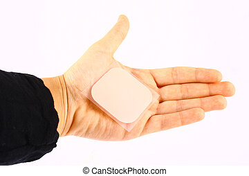 contraception - Palm of woman holds contraceptive adhesive ...