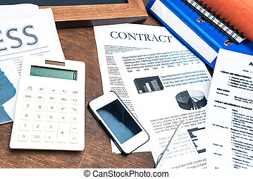 contract documents, smartphone, calculator and business...