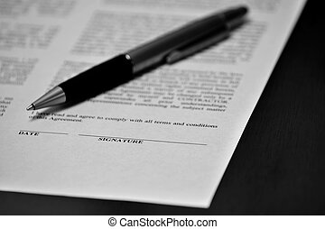 Contract on Desk with Black Pen