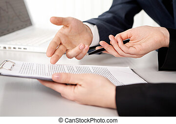 Contract point - Hands of two businesspeople discussing a...