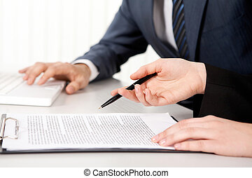 Contract - Female hands with a pen over contract