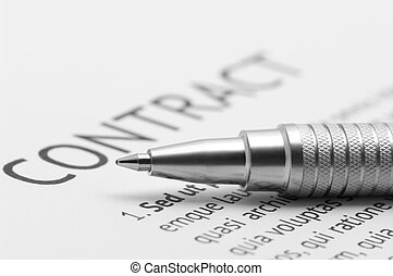 Contract - Close-up of silver pen on contract. Selective...