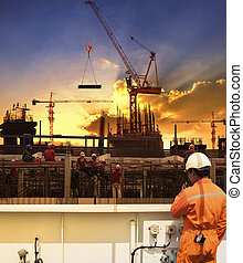 contractor and construction worker working in building construction site