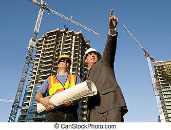 Contractor and Foreman - Contractor and foreman at the job...