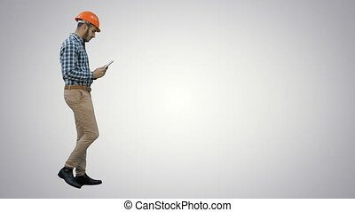 Contractor engineer inspecting construction site holding digital tablet on white background.