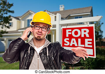 Contractor in Hard Hat in Front of House and Sign
