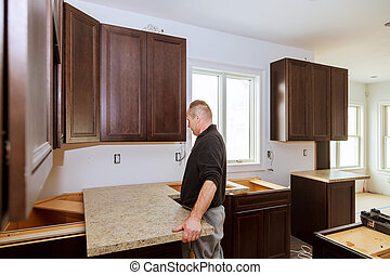 Contractor installing a new laminate kitchen counter top...