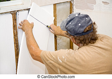 Contractor Installing Insulation - Contractor installing...