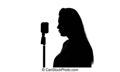 Contractor insulated and sings a song. Close up. Silhouette. White