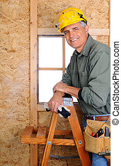 Contractor Leaning on Ladder - Closeup of a carpenter ...
