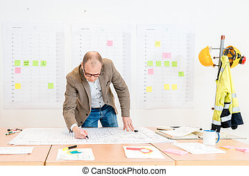 Contractor Making Architectural Plan In Conference Room