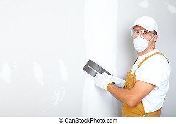 Mature contractor plasterer working indoors