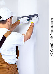 Contractor plasterer - Mature contractor plasterer working ...