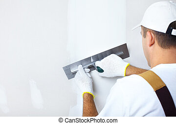 Contractor plasterer - Mature contractor plasterer working...
