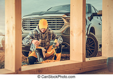Contractor Preparing His Toolbox in Front of Pickup Truck