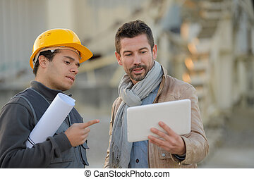 contractor showing to the industrial designer the concept
