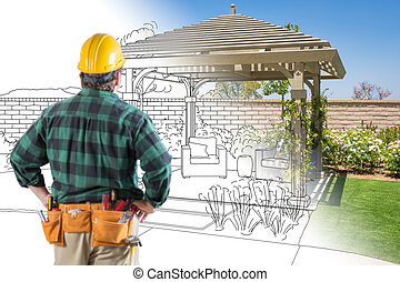 Contractor Standing Looking At Patio Pergola Design Drawing and Photo Combination.