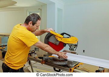 Contractor Using Circular Saw Cutting Crown Moulding for ...