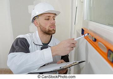 Contractor using spirit level