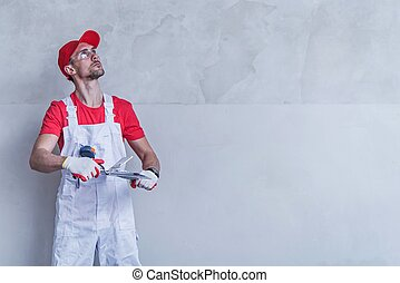 Contractor Wall Patching - Caucasian Contractor in His 30s...
