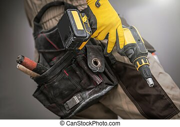 Contractor with Power Tool. Construction Worker with Drill...