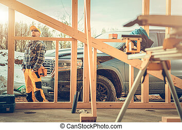 Contractor Worker, His Pickup Truck and the Construction Site