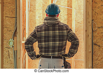 Contractor Worker in Front of Newly Built House Interior