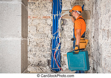 Contractor Worker with Tools in His Hand
