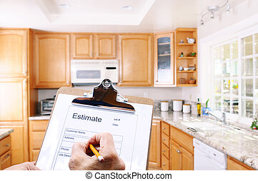 Closeup of a contractors clipboard as he write up an estimate for a kitchen remodel. Shallow depth of field with focus on clipboard.