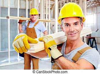 Young handsome contractors in yellow uniform.