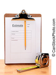 Closeup of a Contractors estimate form with a pencil and tape measure on a wooden table. Vertical witha white background.