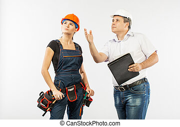 contractors people discussing the plan of building over white background