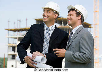 Contractors - Photo of successful architect with foreman...