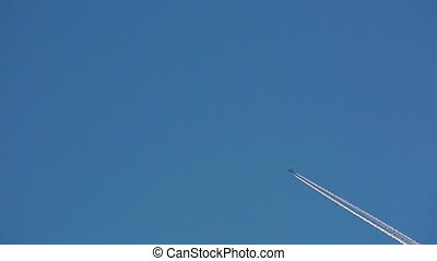 Contrail - Jet airplane with trail against the blue sky