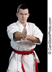 Contrast karate young fighter on black