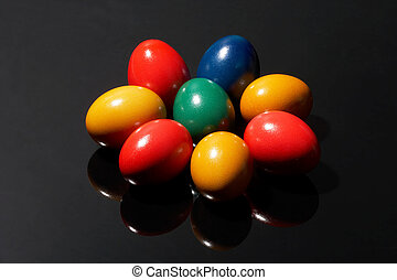 contrast - many coloured eggs on black background - mehrere...
